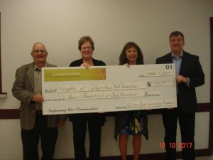 Cheque presentation to Knights of Columbus to contribute to costs for new lighting, bathroom flooring, entrance door and kitchen cupboards.